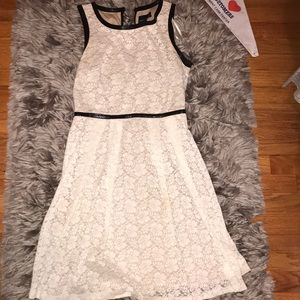 White/cream lace dress with black leather details